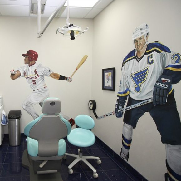 Saint Louis Cardinals and Blues athletes on walls of dental treatment room