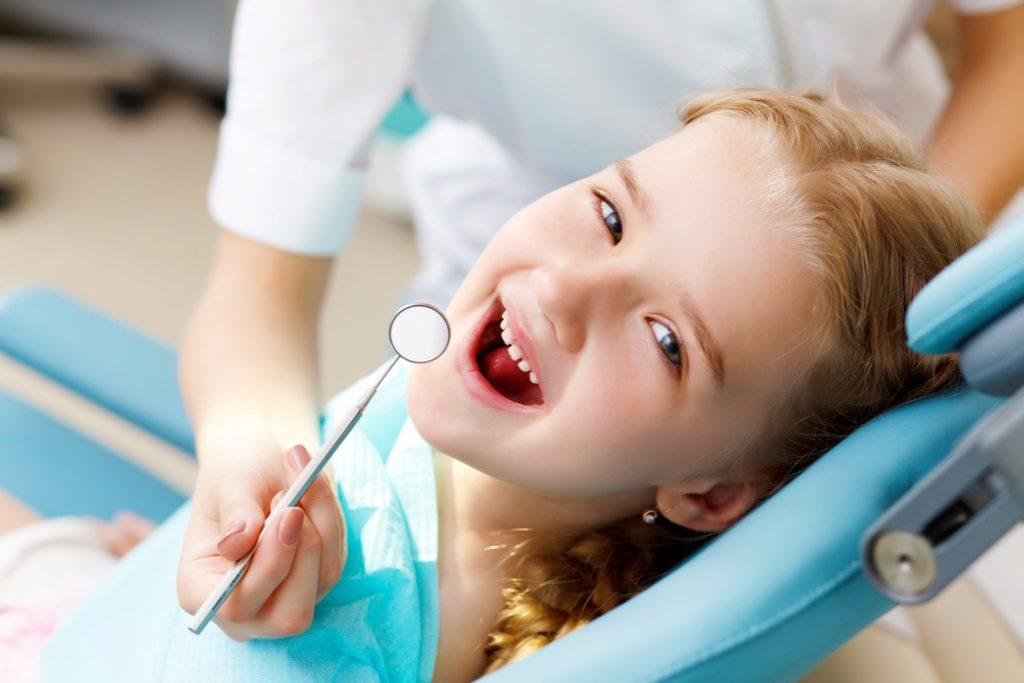 Closeup of child smiling during dental checkup